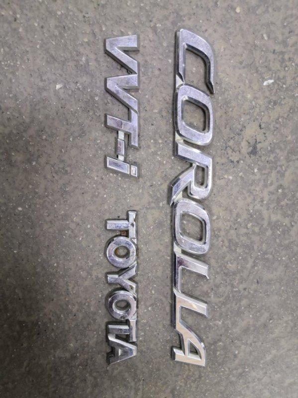 Эмблема Toyota Corolla E120 4ZZ FE 2000 задняя (б/у)