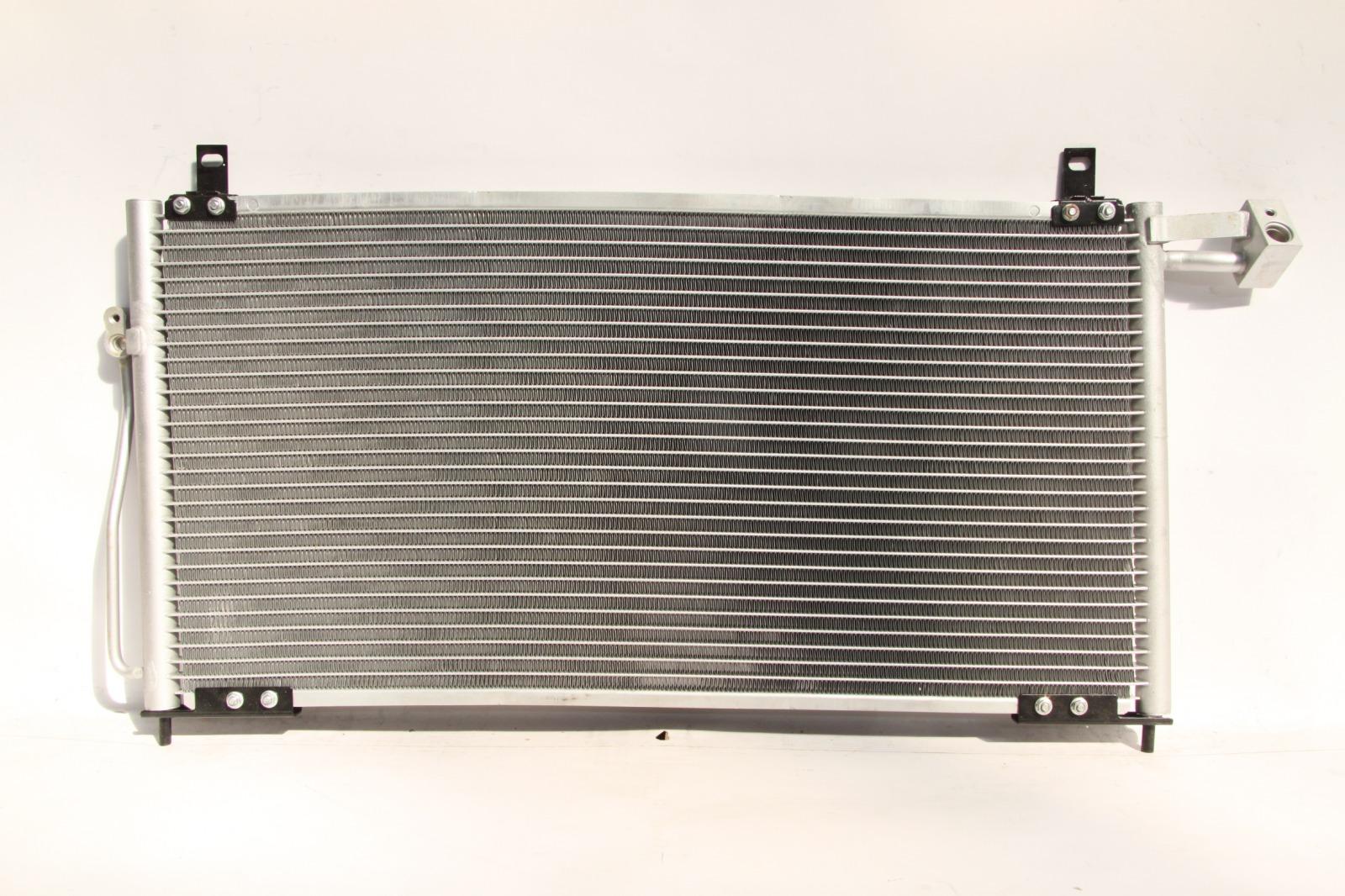 Радиатор кондиционера Mazda 323 2001