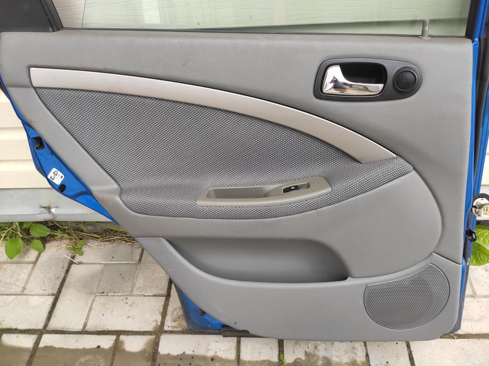 Обшивка двери Chevrolet Lacetti УНИВЕРСАЛ 1.6 задняя левая (б/у)