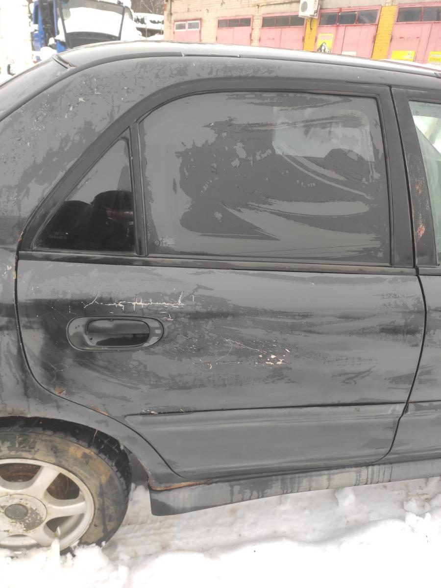 Дверь Mitsubishi Carisma СЕДАН 1.8 GDI 1999 задняя правая (б/у)