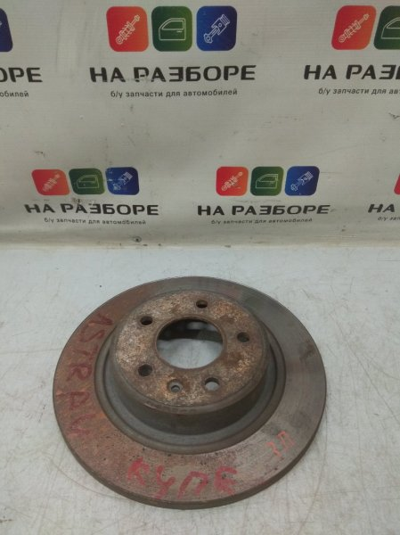 Тормозной диск Opel Astra J задний правый (б/у)