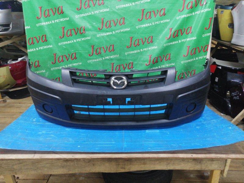 Бампер Mazda Familia VY12 HR15DE 2010 передний (б/у) ПОТЕРТОСТИ. ДЕФЕКТ КРЕПЛЕНИЯ
