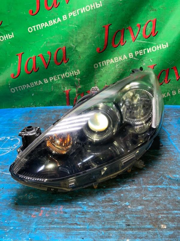 Фара Mazda Demio DE5FS ZY-VE 2009 передняя левая (б/у) P9489. ВЕРХНЕЕ КРЕПЛЕНИЕ РЕМОНТНОЕ.