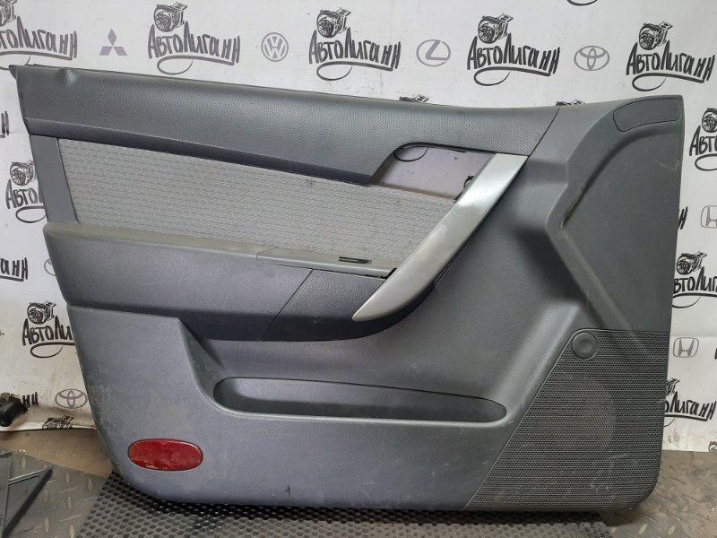 Обшивка двери Chevrolet Aveo T 255 ХЭТЧБЕК F14D4 2009 (б/у)