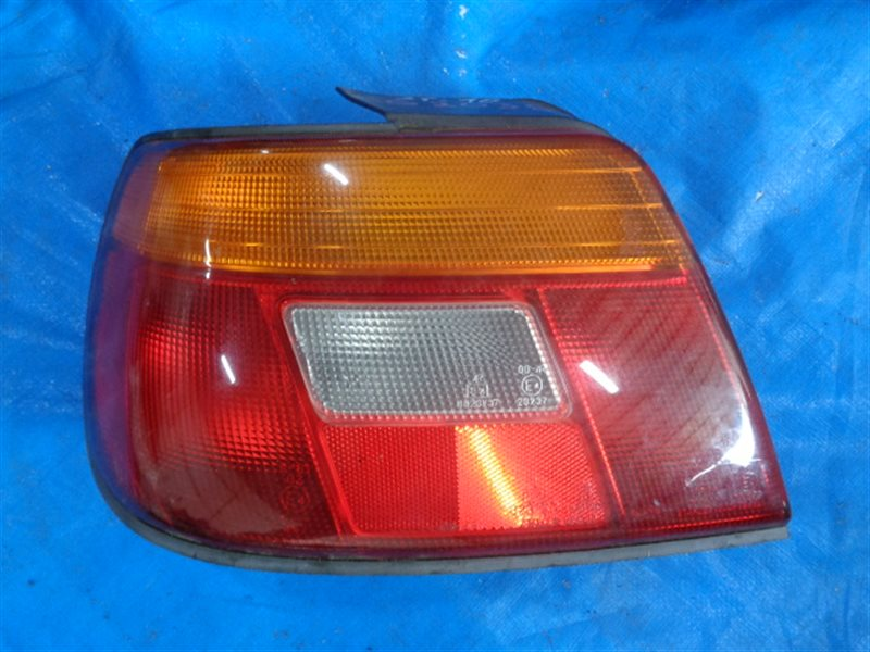 Стоп-сигнал Daihatsu Charade G203S левый 043-1999 (б/у)