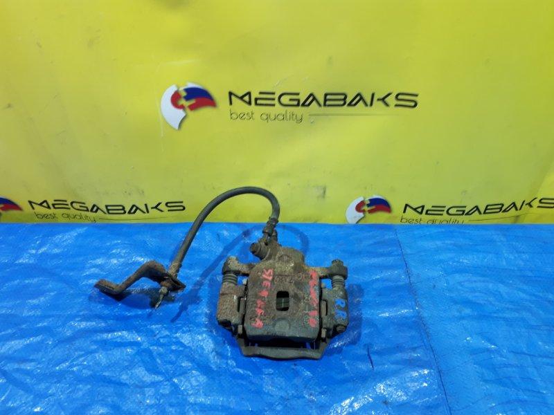 Суппорт Nissan Stagea WGNC34 задний правый (б/у)