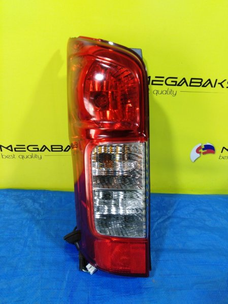 Стоп-сигнал Nissan Caravan E26 левый T008 (б/у)