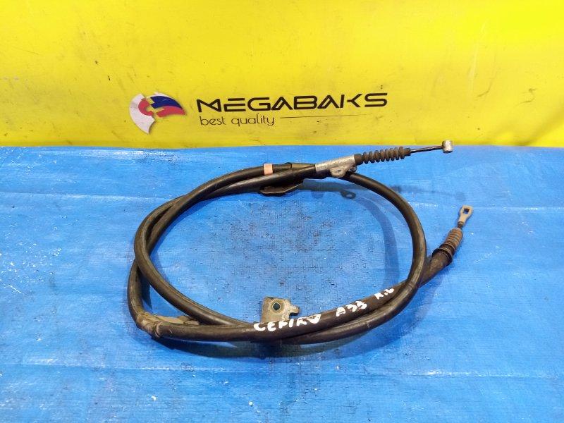 Тросик ручника Nissan Cefiro A33 VQ20DE задний левый (б/у)