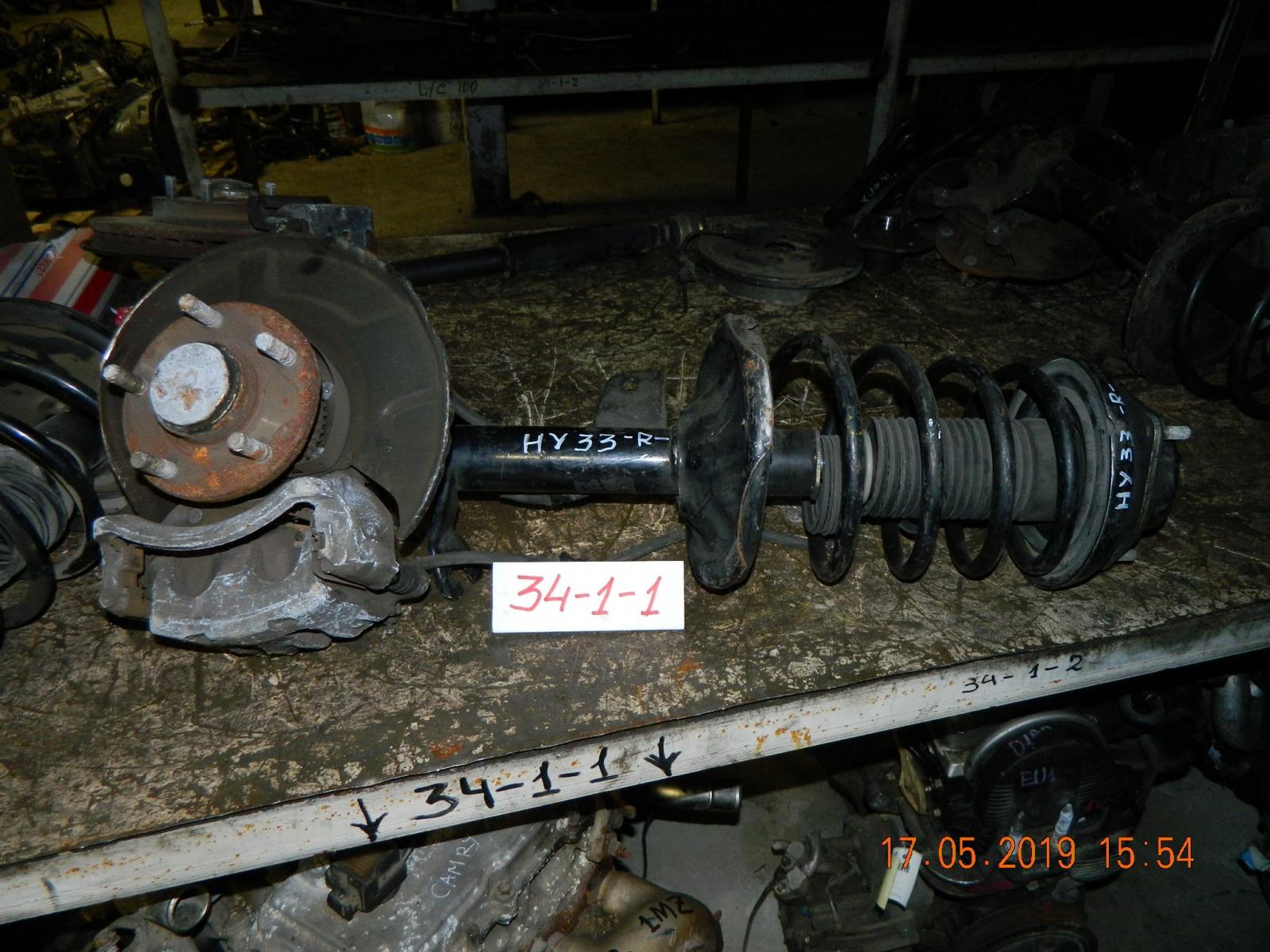 Стойка подвески Nissan Cedric ENY33 передняя правая (б/у)