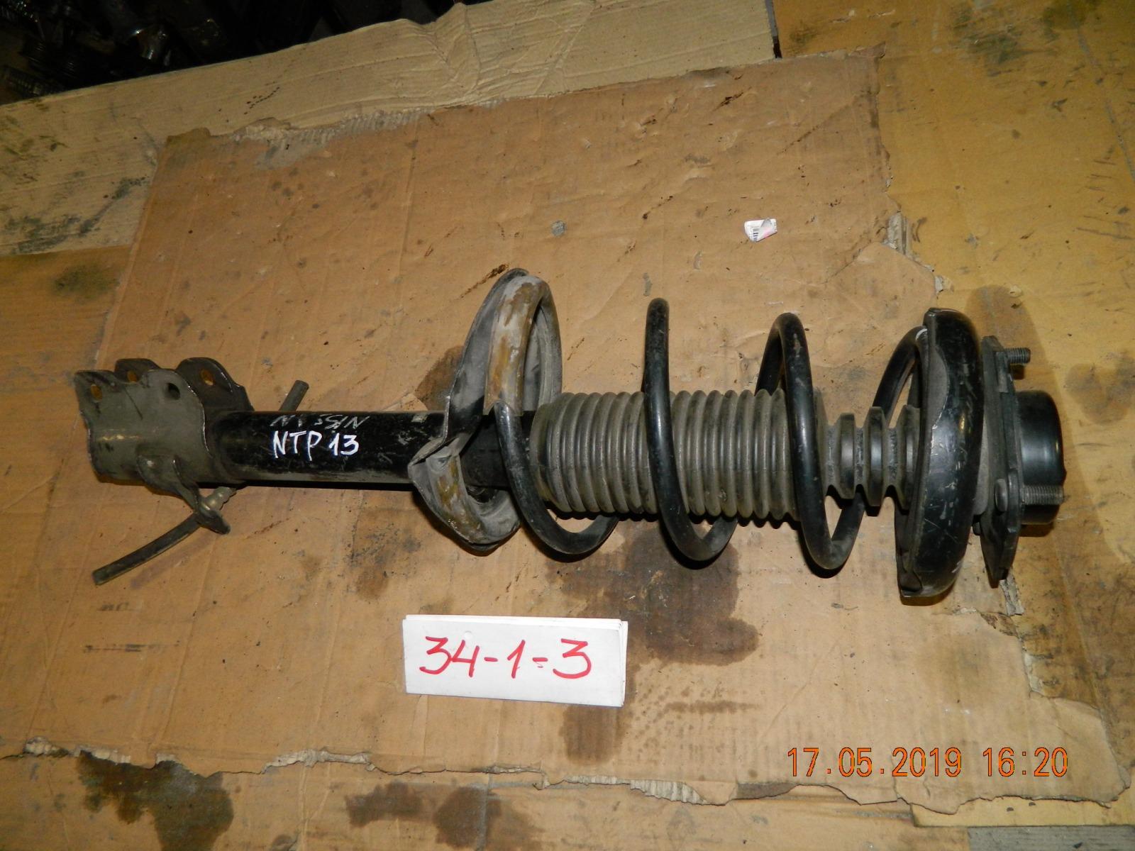 Стойка подвески Nissan Pulsar N13 передняя правая (б/у)
