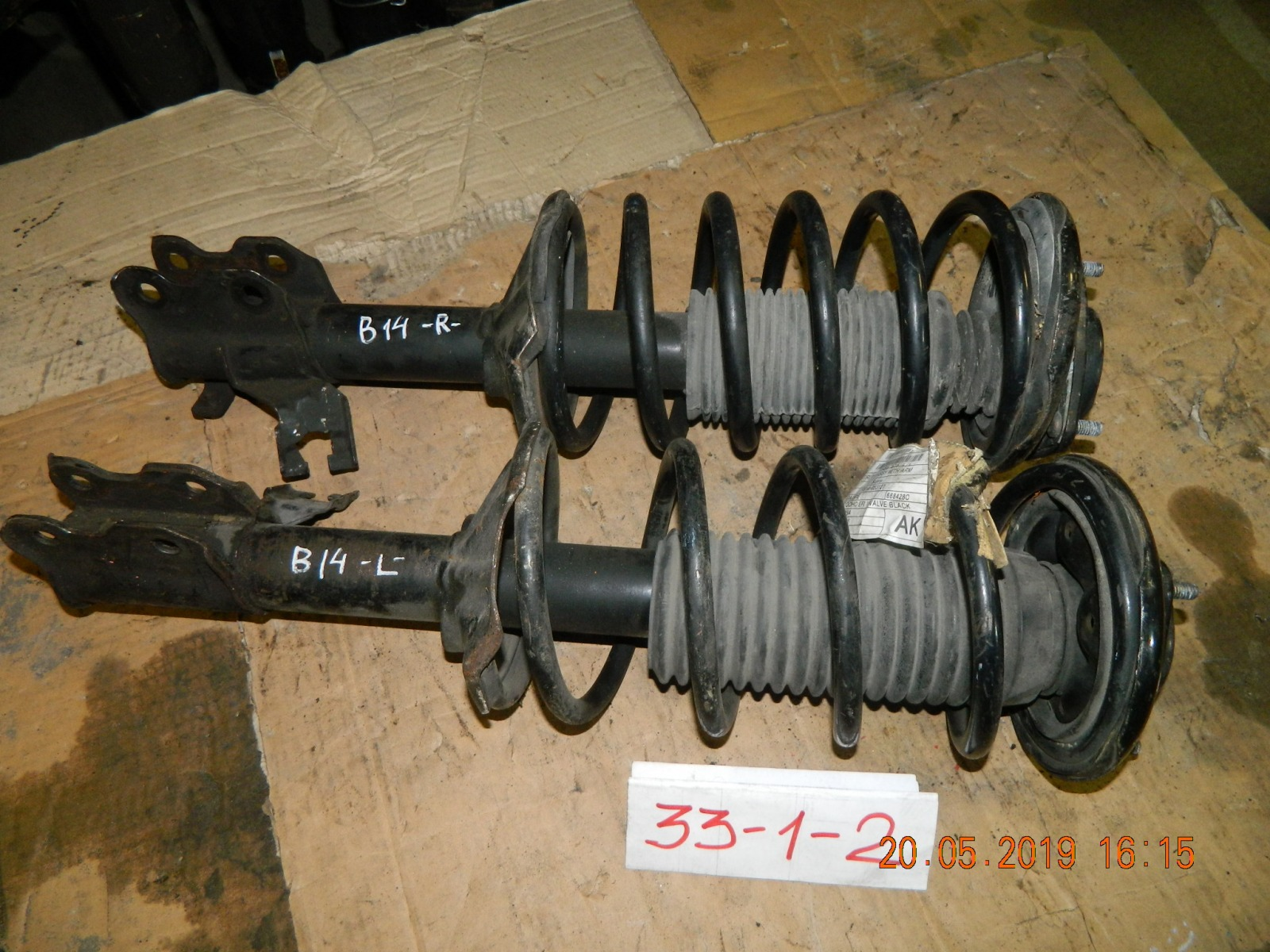 Стойка подвески Nissan Pulsar N14 передняя (б/у)