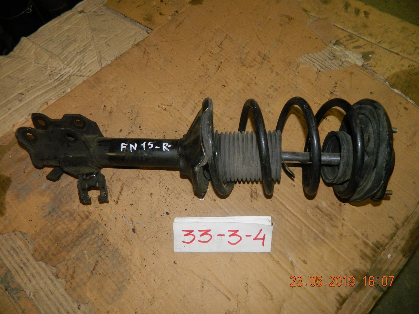 Стойка подвески Nissan Pulsar N15 передняя правая (б/у)
