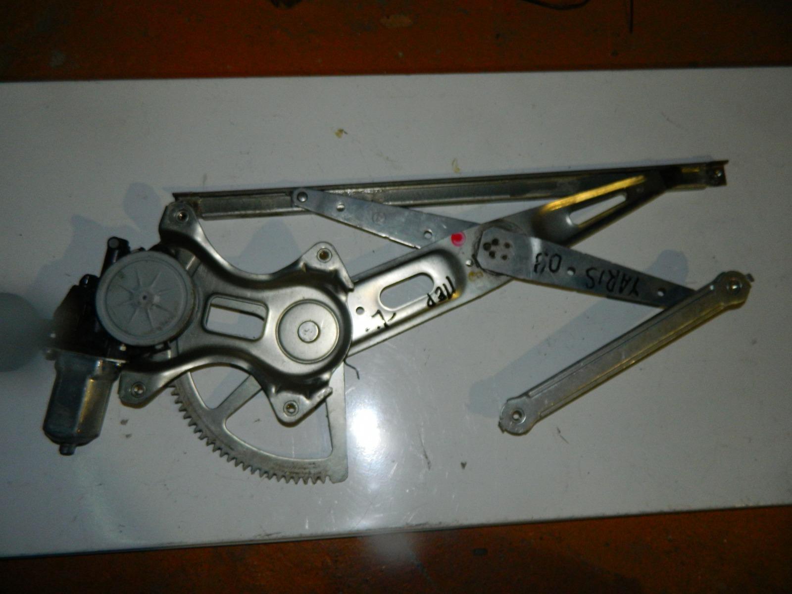 Механизм стекло-подъёмника. Toyota Yaris передний левый (б/у)