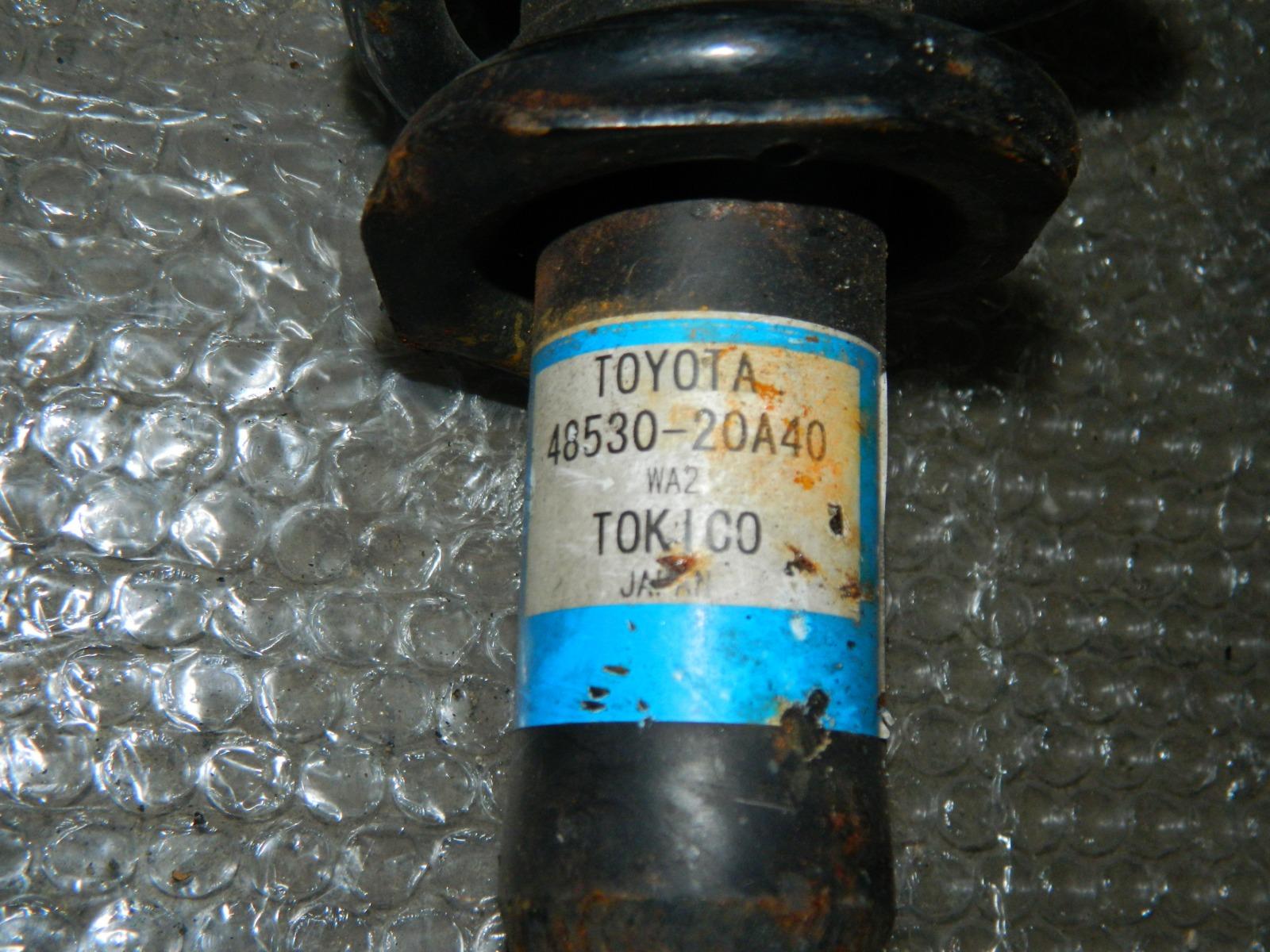 Стойка подвески Toyota Allion ZRT261 задняя левая (б/у)