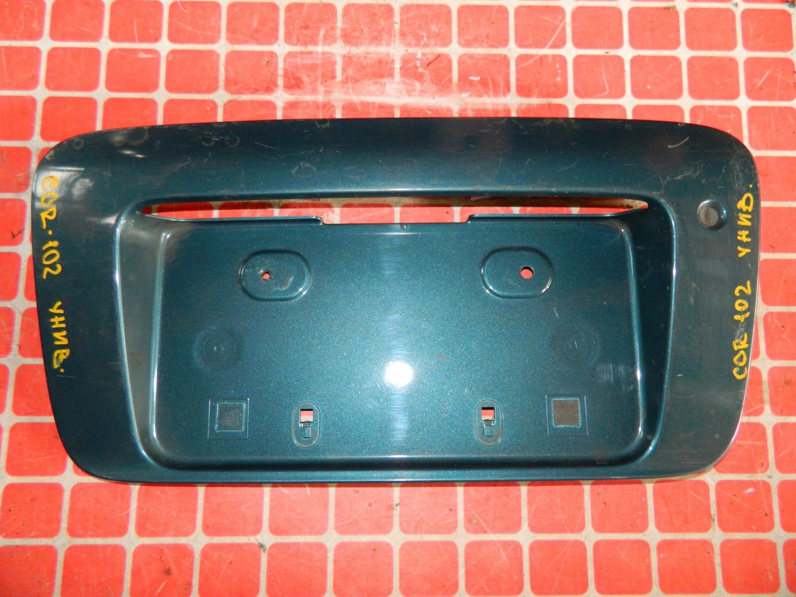 Накладка под номерной знак Toyota Corolla AE102 задняя (б/у)