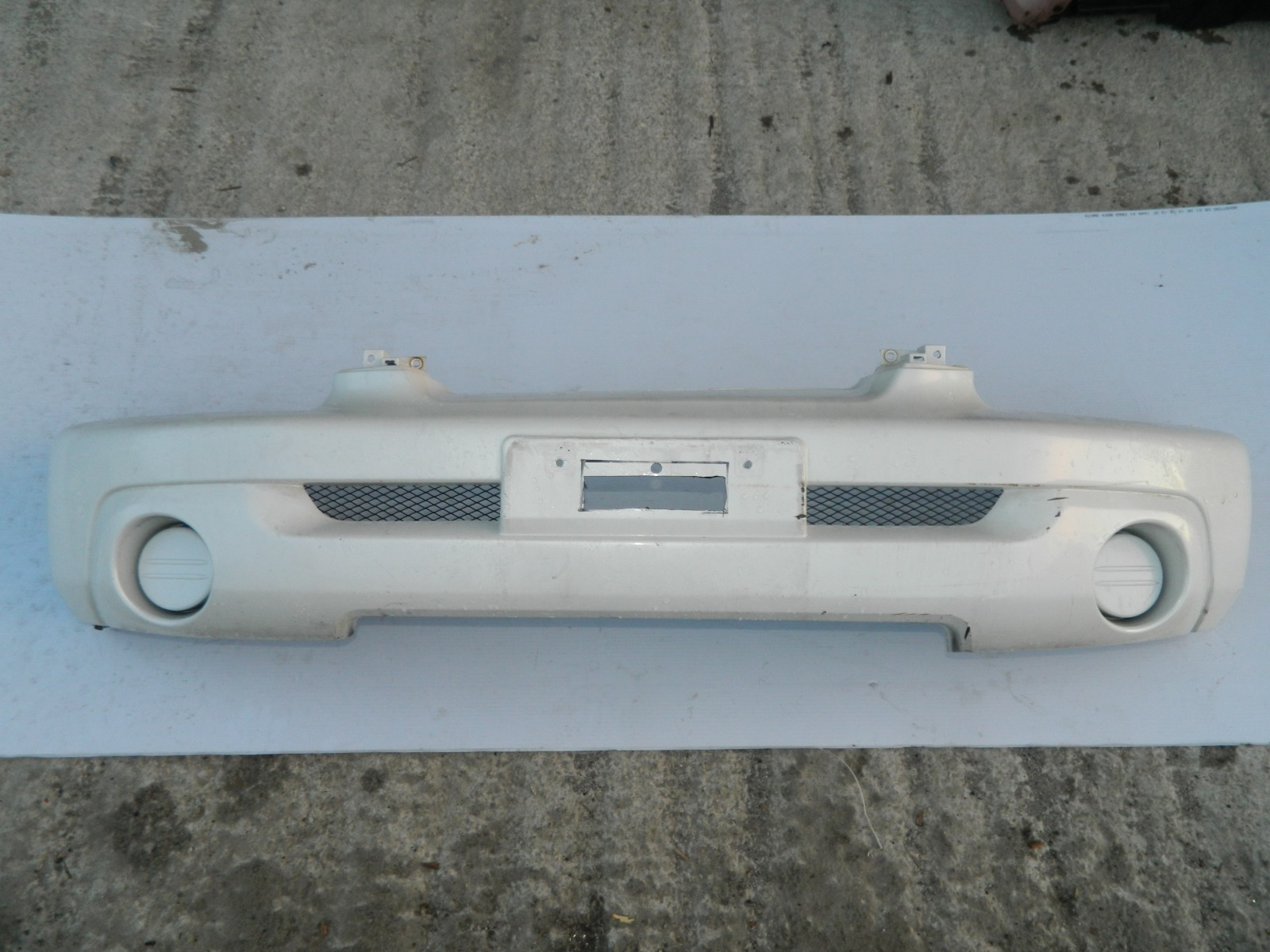 Бампер Mitsubishi Pajero Io H67W передний (б/у)