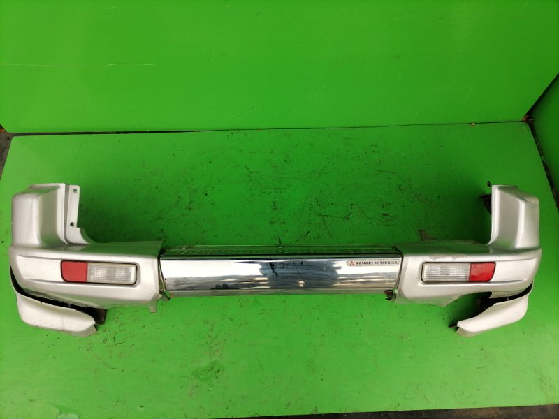 Бампер Mitsubishi Pajero V68W задний (б/у)