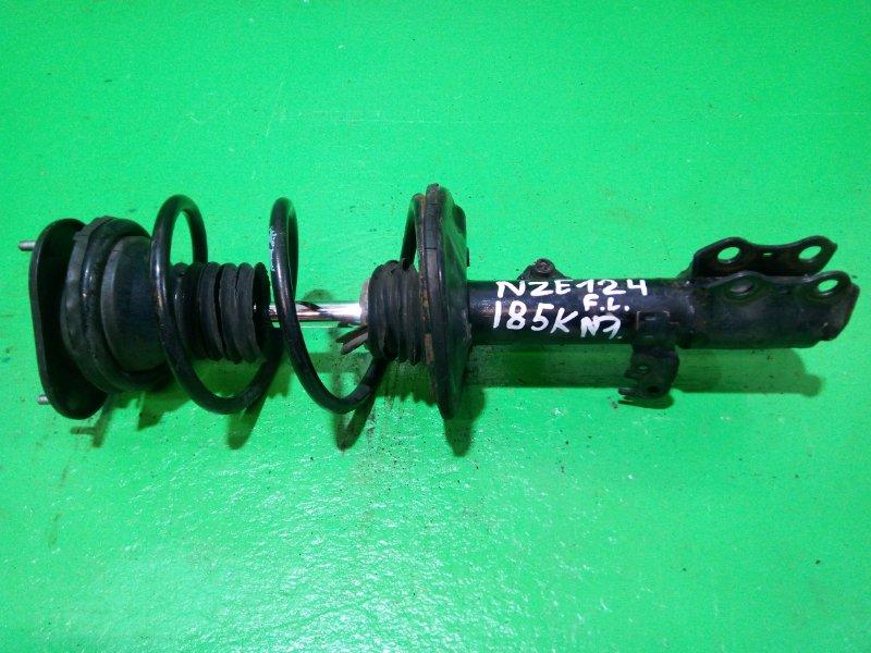 Стойка Toyota Runx NZE124 передняя левая (б/у) №1