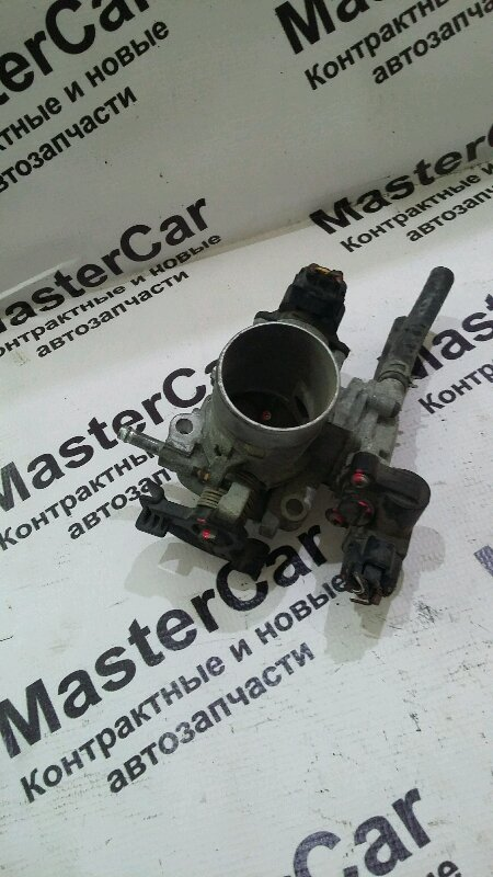 Дросельная заслонка Toyota Funcargo NCP21 1NZFE (б/у) 22210-21010 toyota 22210-21010