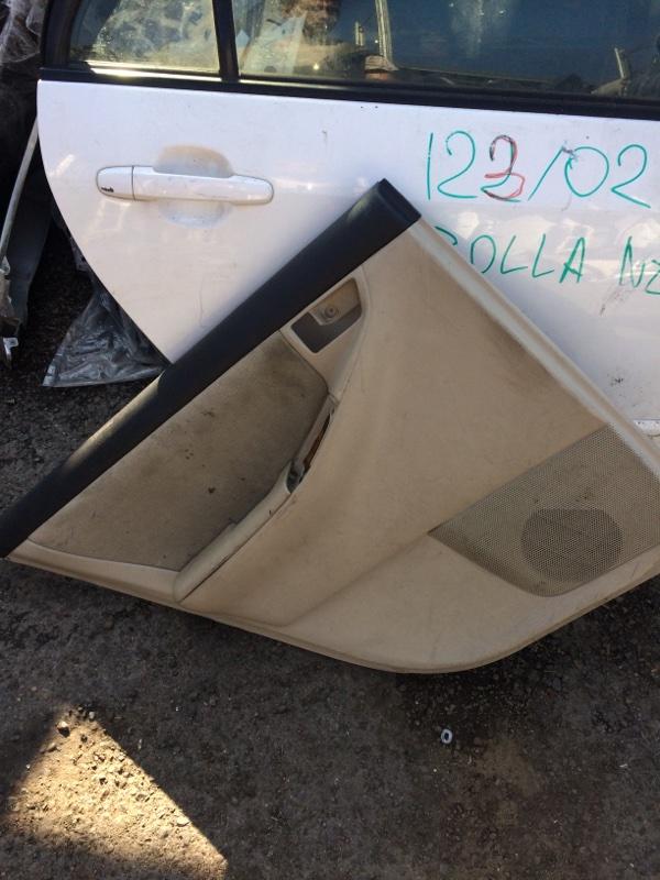 Обшивка двери Toyota Corolla NZE120 задняя левая (б/у)