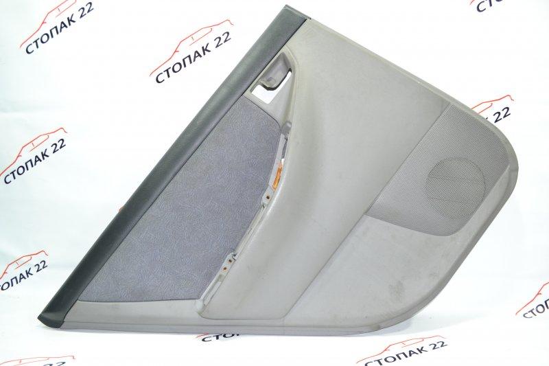 Обшивка двери Toyota Corolla NZE120 1NZ 2000 задняя левая (б/у)