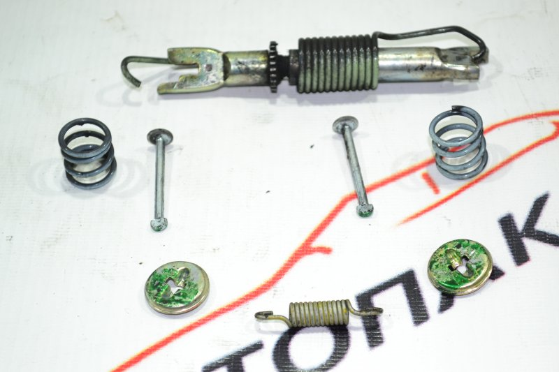 Механизм стояночного тормоза Toyota Corolla NZE121 1NZ 2001 задний левый (б/у)