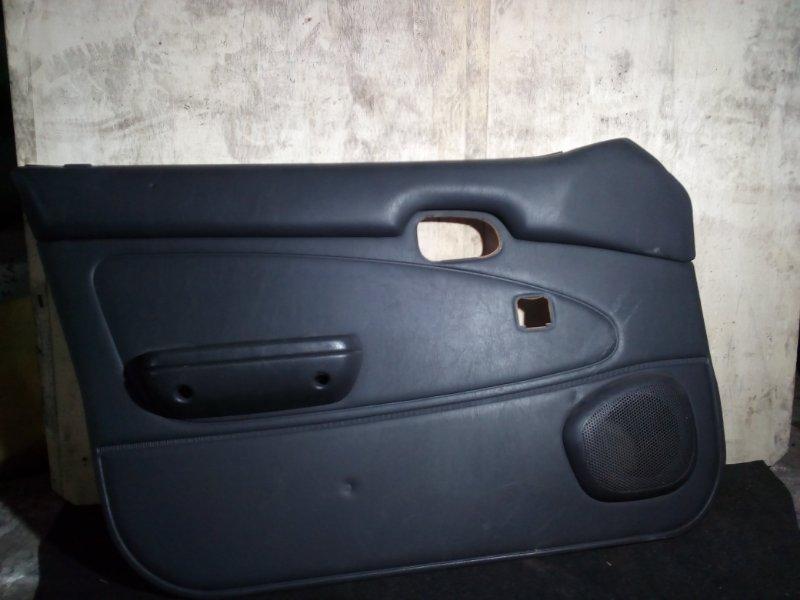 Обшивка двери Toyota Corolla AE100 передняя левая (б/у)