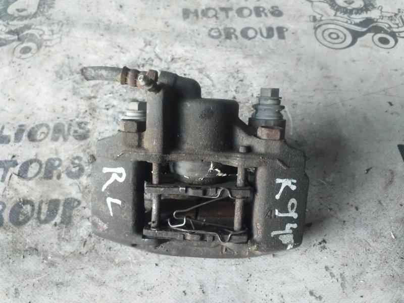 Суппорт Mitsubishi Montero K94W задний левый (б/у)