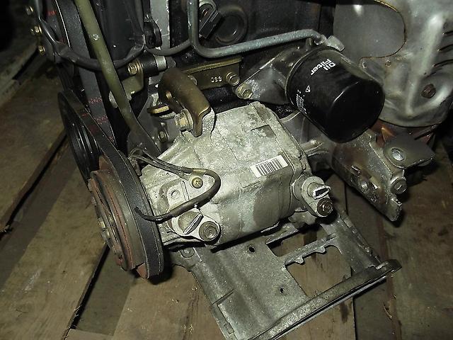 Компрессор кондиционера Toyota Duet M100A EJ-DE