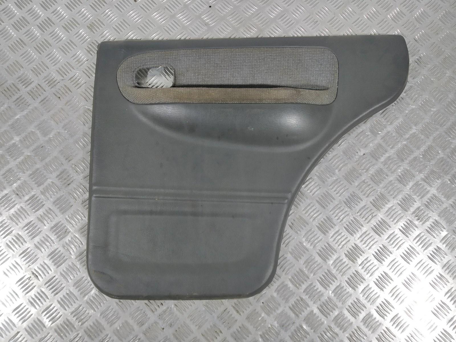 Обшивка двери задней правой (дверная карта) Kia Sportage 2.0 I 2003 (б/у)
