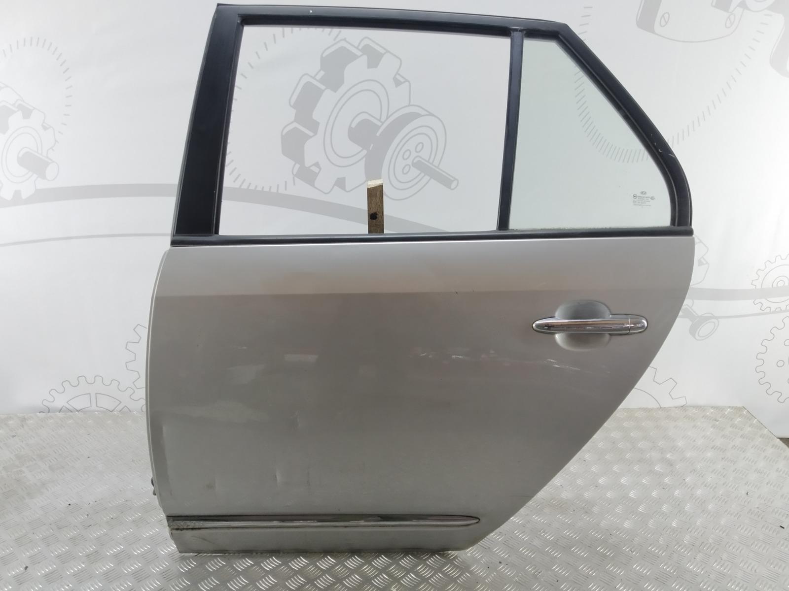 Дверь задняя левая Kia Carens 2.0 CRDI 2006 (б/у)