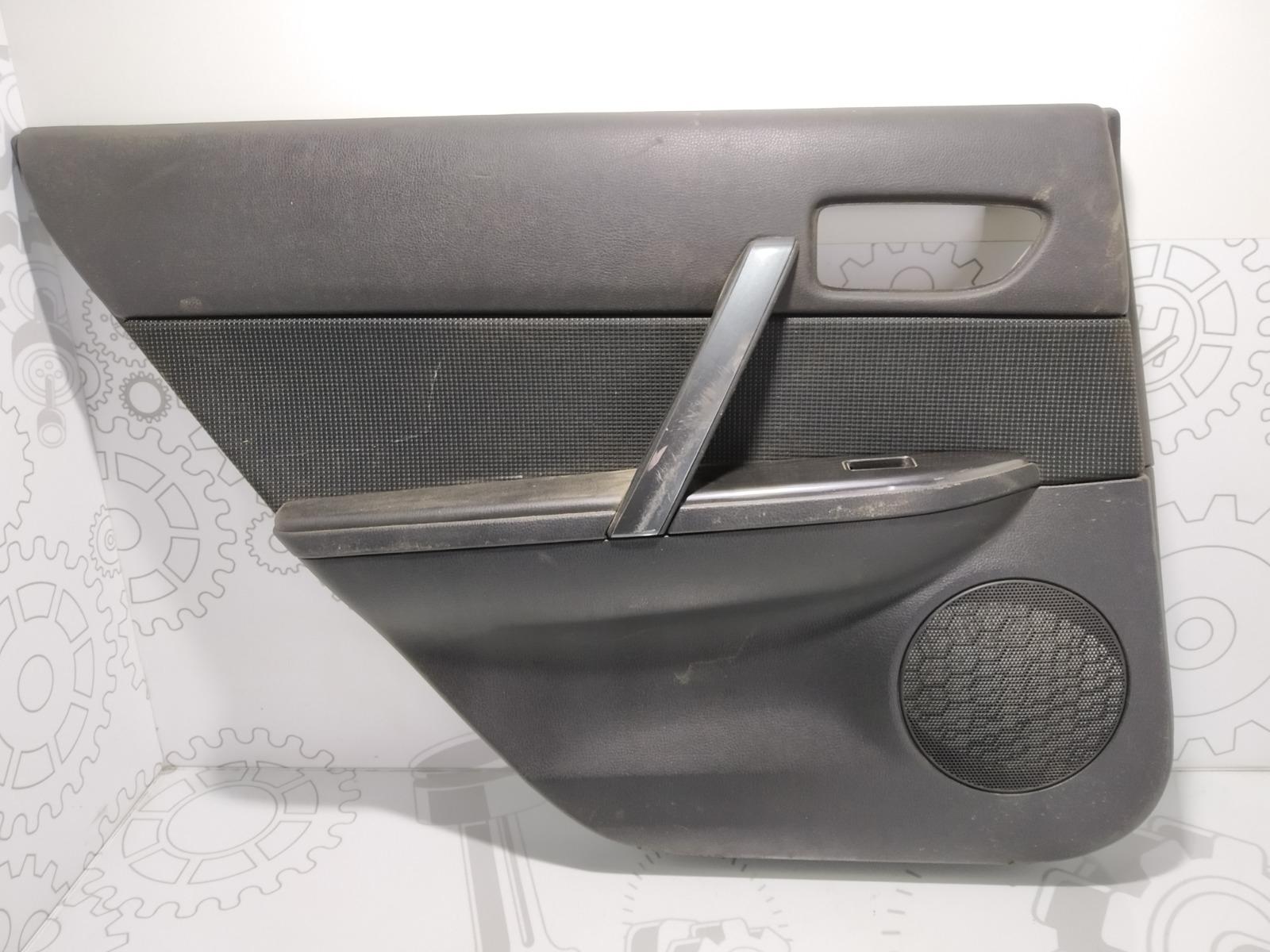 Обшивка двери задней левой (дверная карта) Mazda 6 2.0 I 2006 (б/у)