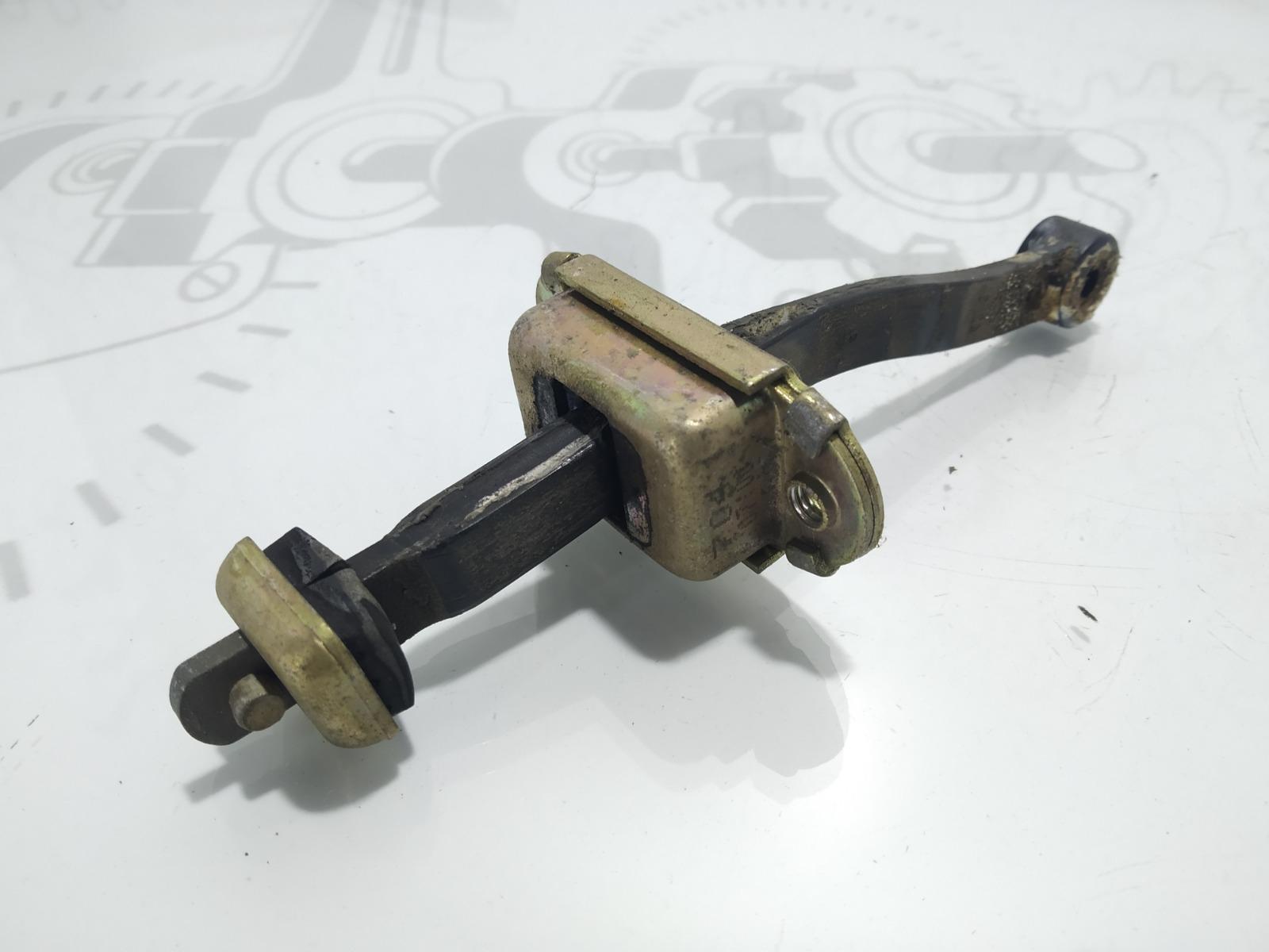 Ограничитель открывания двери Nissan Vanette C23 2.3 D 2001 (б/у)