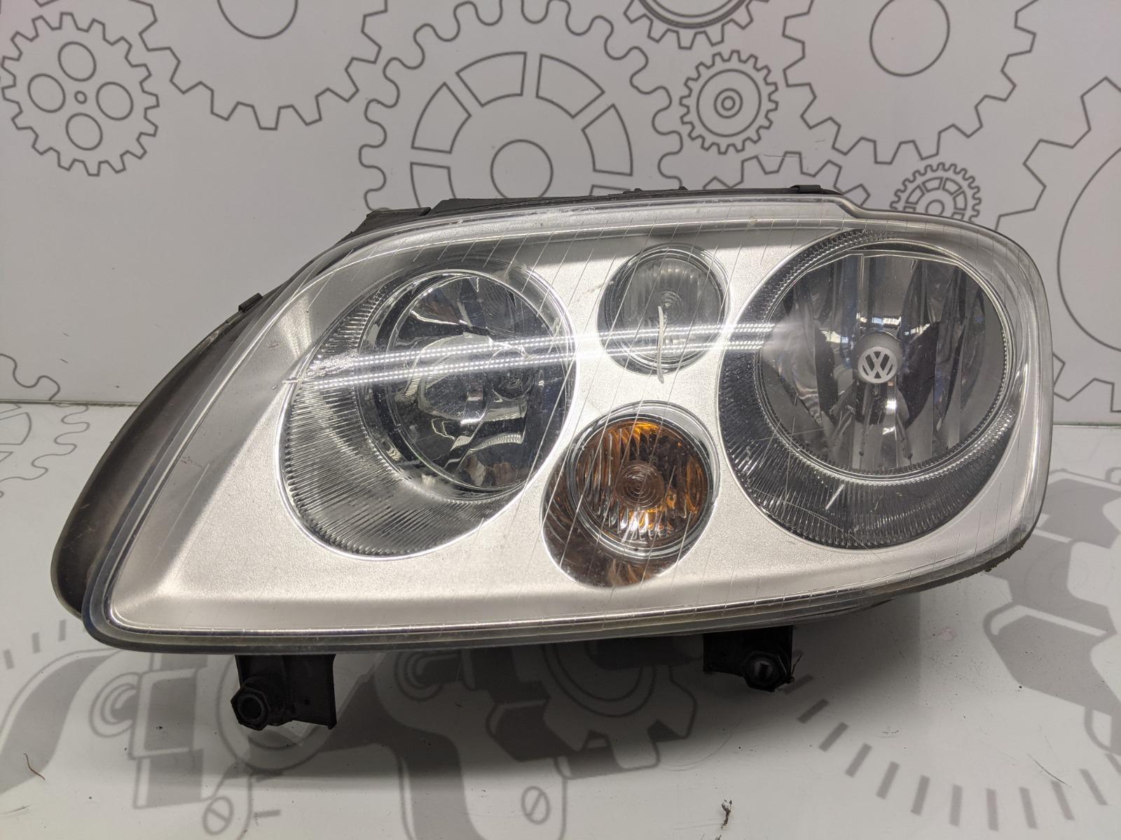Фара левая Volkswagen Touran 2.0 TDI 2006 (б/у)