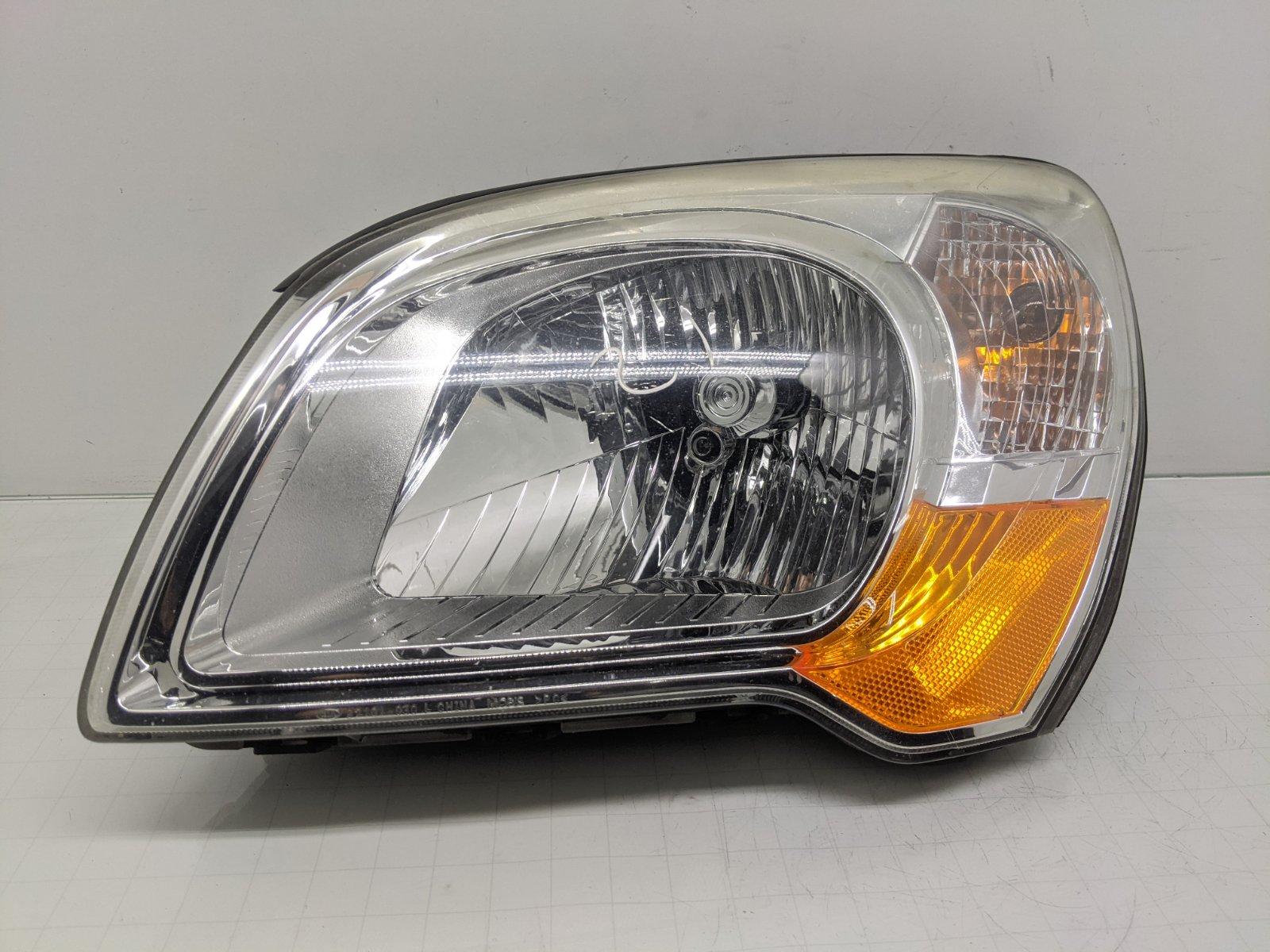 Фара левая Kia Sportage 2.0 CRDI 2009 (б/у)