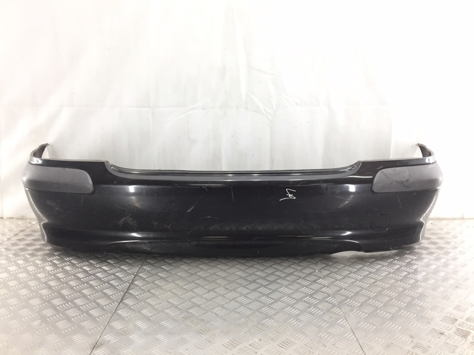Бампер задний Nissan Almera N16 1.8 I 2002 (б/у)