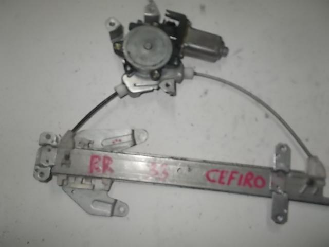 Стеклоподъемник Nissan Cefiro A33 задний правый (б/у)