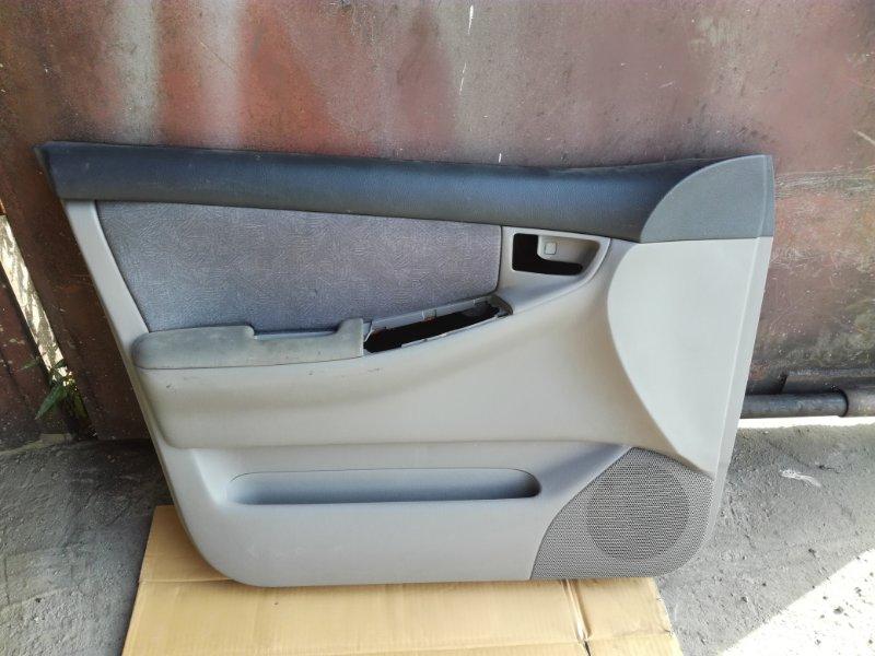 Обшивка двери Toyota Corolla NZE120 2ZZGE передняя левая