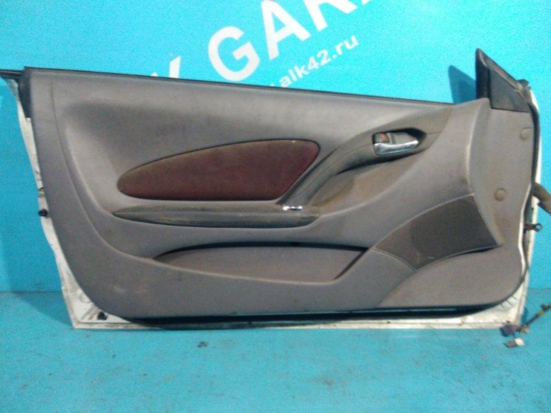 Обшивка двери Toyota Celica ZZT230 1ZZFE передняя левая