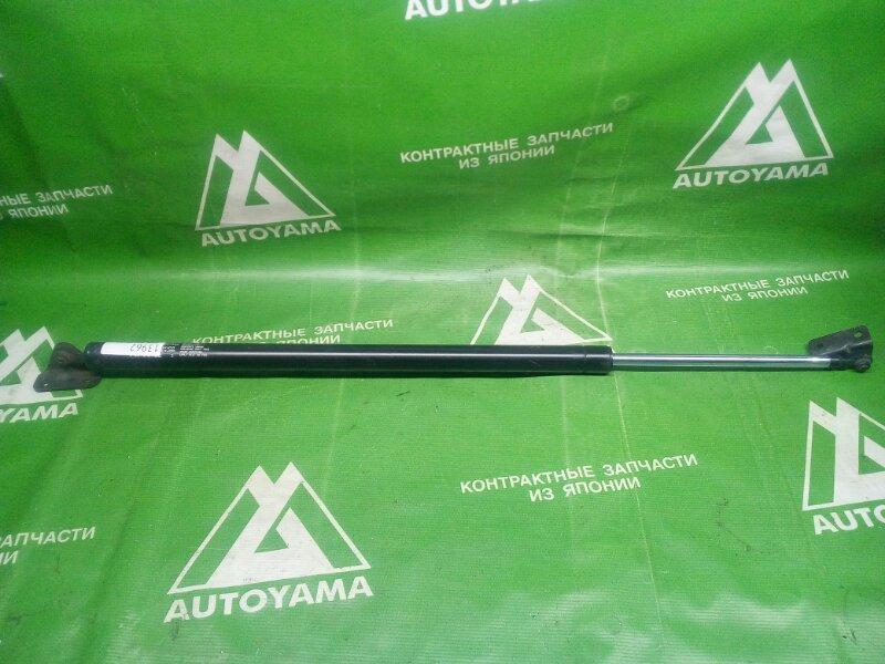 Амортизатор багажника Mitsubishi Delica P35W задний правый (б/у)