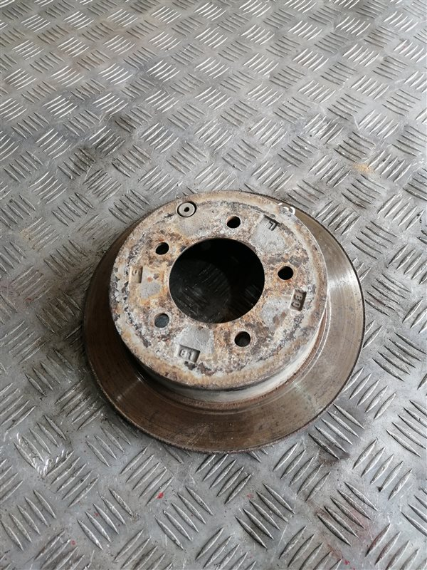 Тормозной диск Mitsubishi Lancer 10 CY2A 4A91 2008 задний правый (б/у)