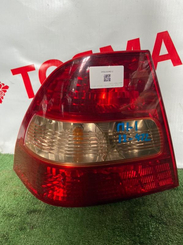 Фонарь Toyota Corolla NZE121 левый