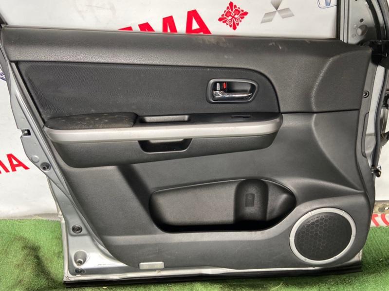 Обшивка дверей Suzuki Escudo TA74W передняя левая