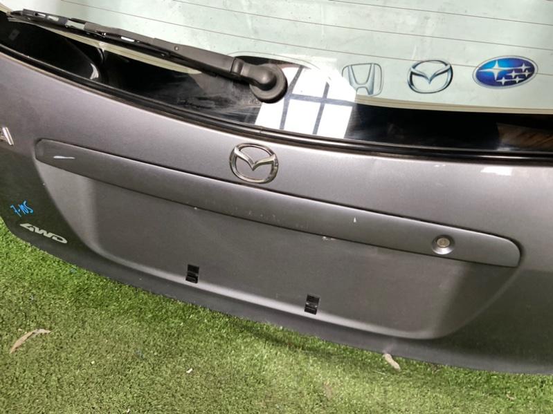 Молдинг крышки багажника Mazda Familia BJ ZL 2002