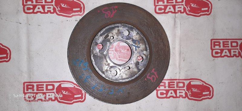 Тормозной диск Toyota Belta SCP92 передний (б/у)