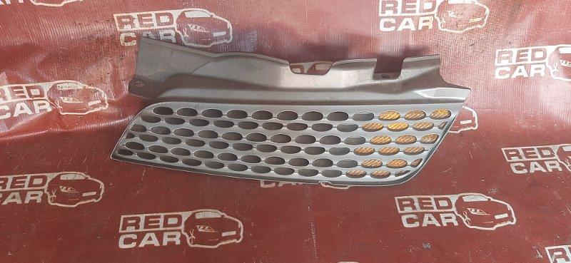 Решетка радиатора Nissan March AK12 передняя левая (б/у)