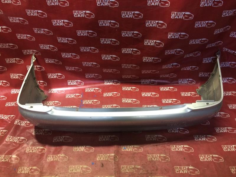 Бампер Mazda Familia BJ5P-309635 ZL-398865 2001 задний (б/у)