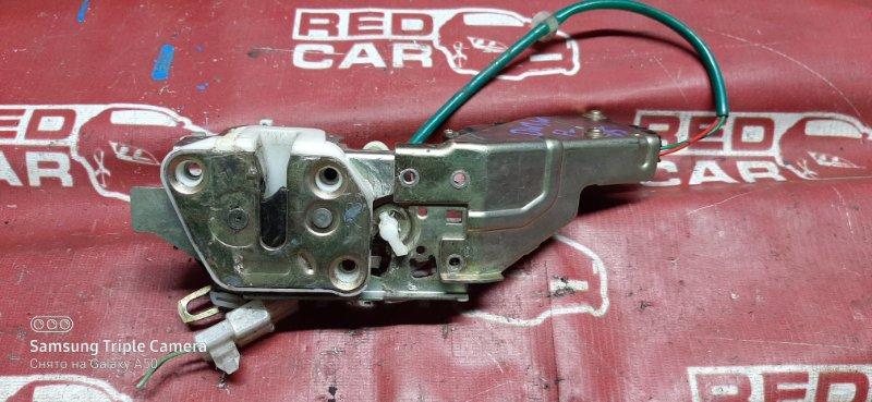 Замок двери Mazda Demio DW3W-317229 B3 1998 передний левый (б/у)