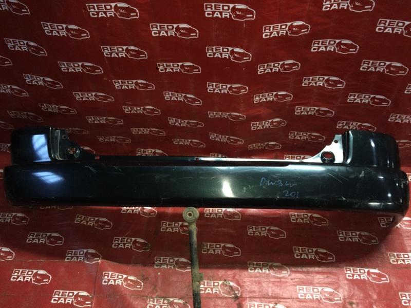 Бампер Mazda Demio DW3W-147186 B3-489336 1997 задний (б/у)