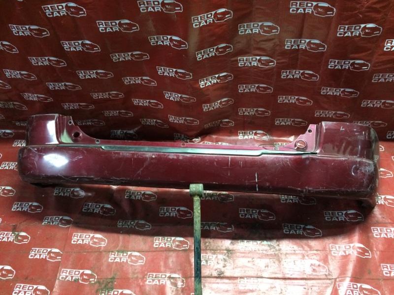 Бампер Mazda Demio DW3W задний (б/у)